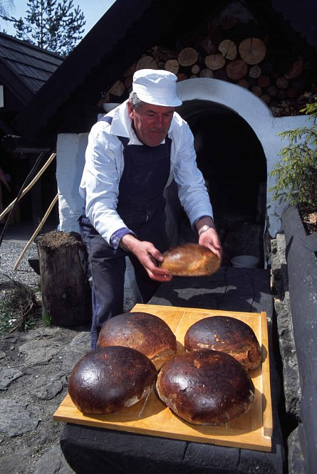 Traditionally baking bread in a municipal oven